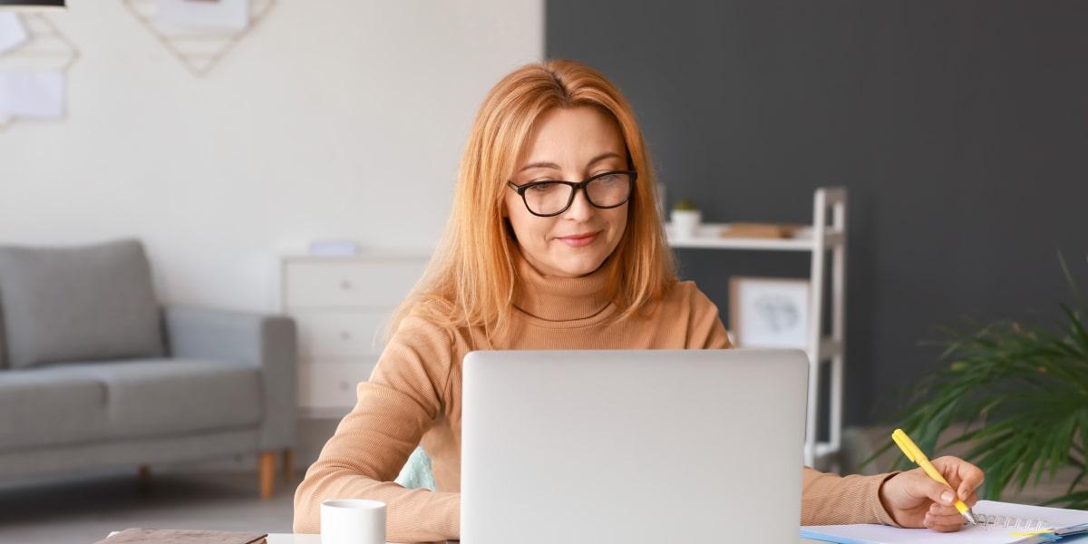 A remote web developer sits at a desk using a version control system