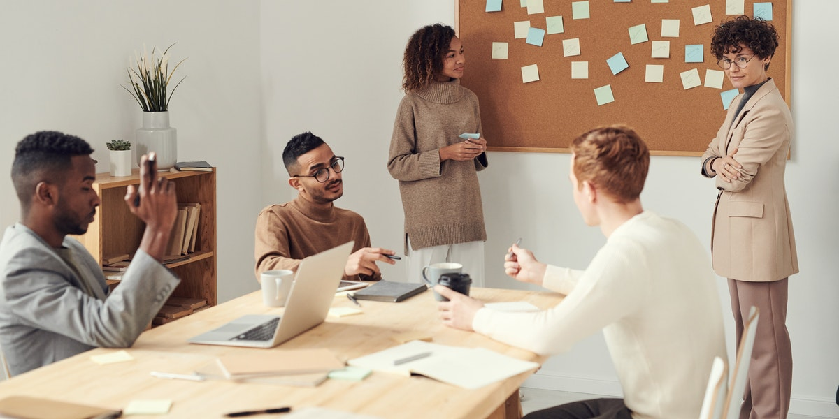 Group of formerly unemployed German residents now collaborate on an ideas session in a startup