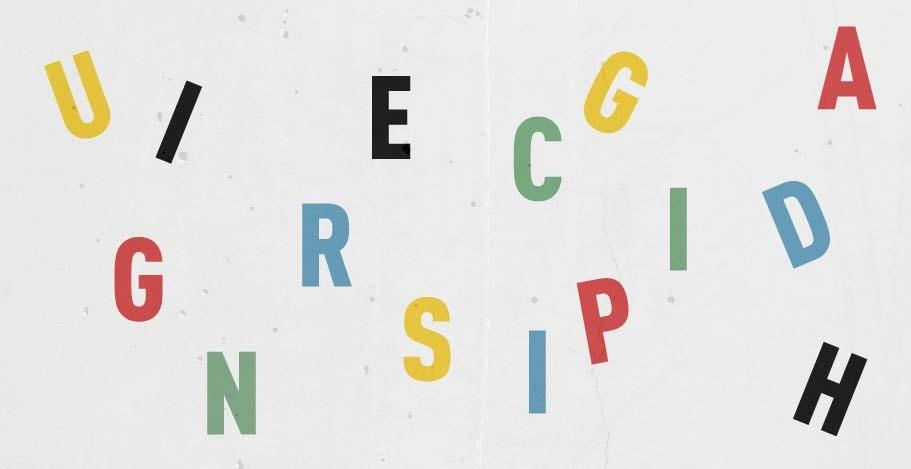Random letters of the alphabet on a plain background
