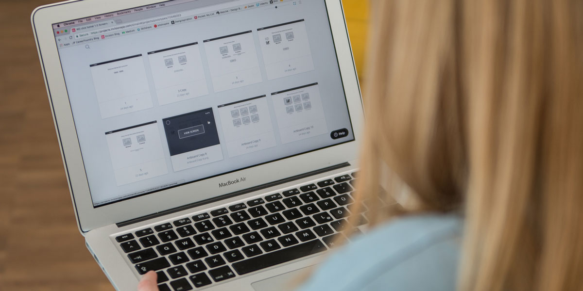 A UI designer working on a laptop