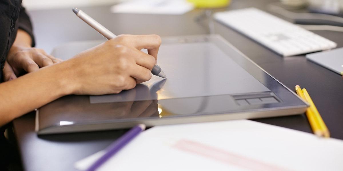 A UI designer sketching on a tablet
