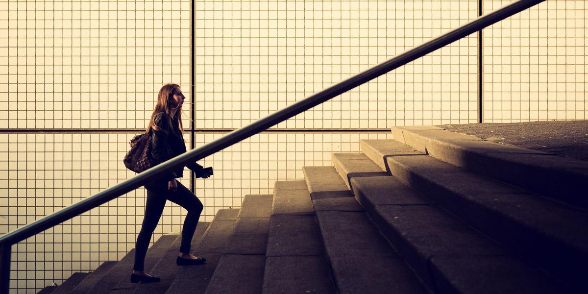 An aspiring UI designer walking up a staircase
