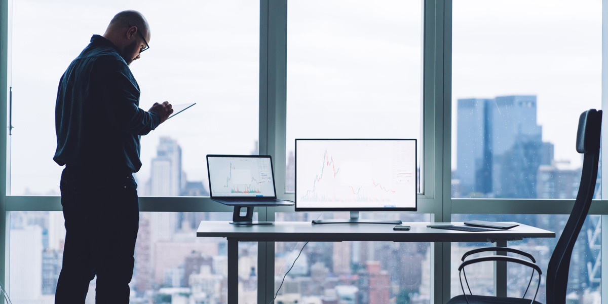 A data analyst standing in a modern office