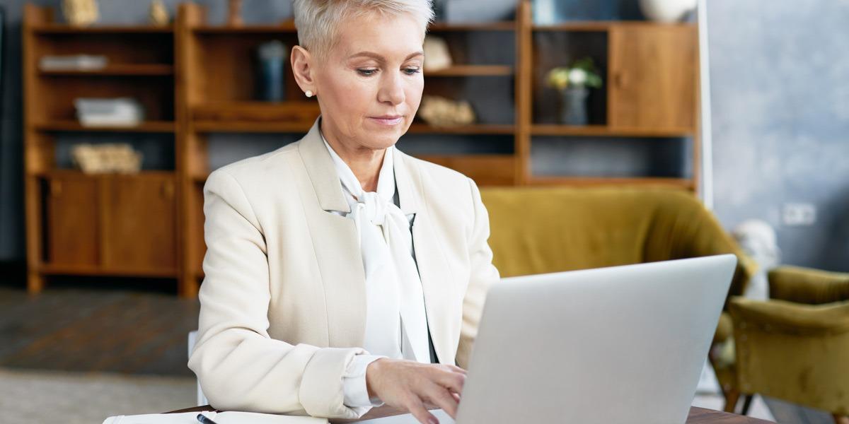 A data analyst building their portfolio on a laptop