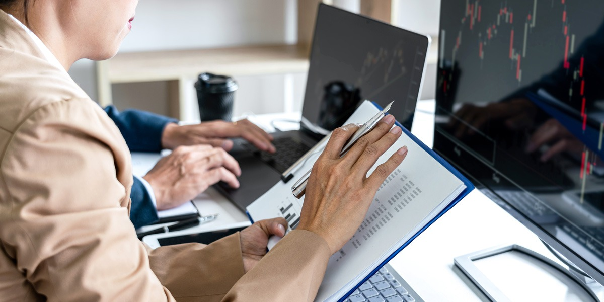 A data analyst looking at a document