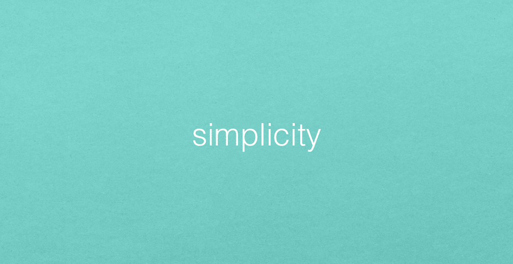 The word SIMPLICITY in white letters on a teal background