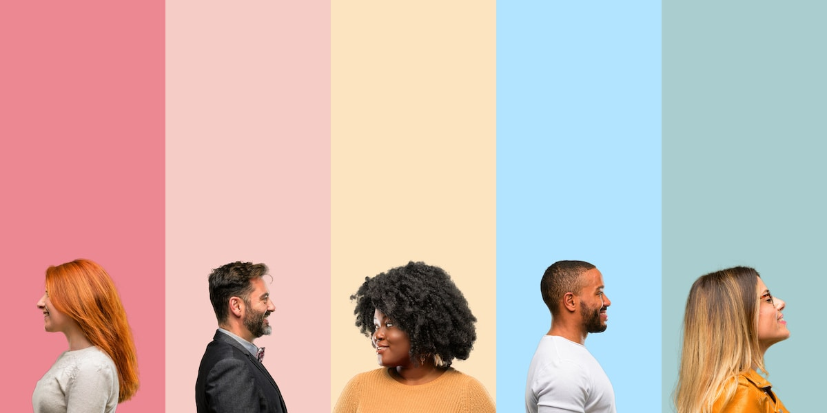 5 people from diverse backgrounds, standing in a row on a colorful, striped background