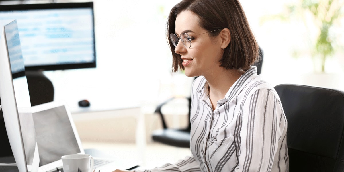 Female JavaScript developer working on code in an office
