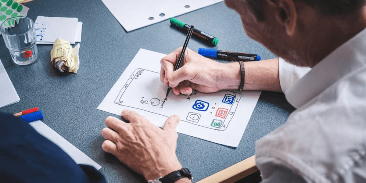 A designer sketching out a wireframe