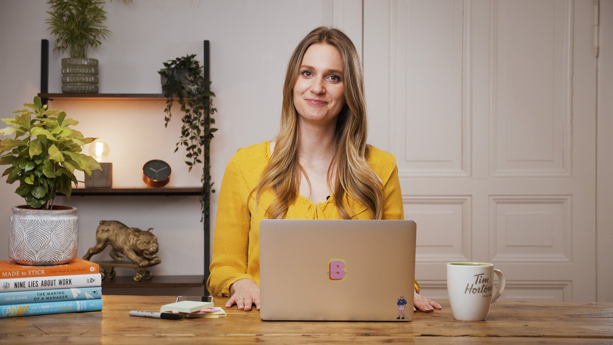Brittni Bowering, content strategist and branding expert, sitting at a desk, smiling