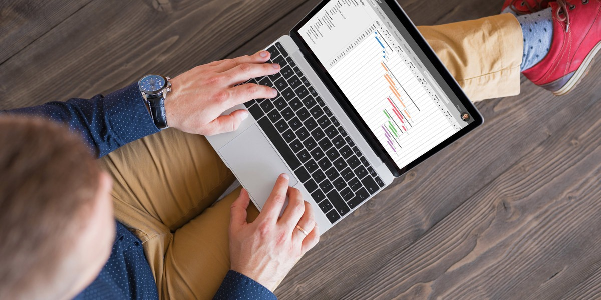 A data analyst on a laptop, creating a pivot table