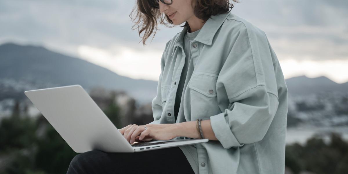 A remote UI designer working on a laptop