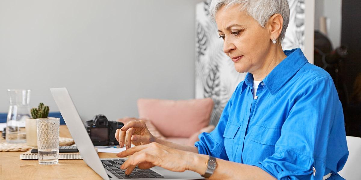 A UX designer sitting at her desk, working on a laptop