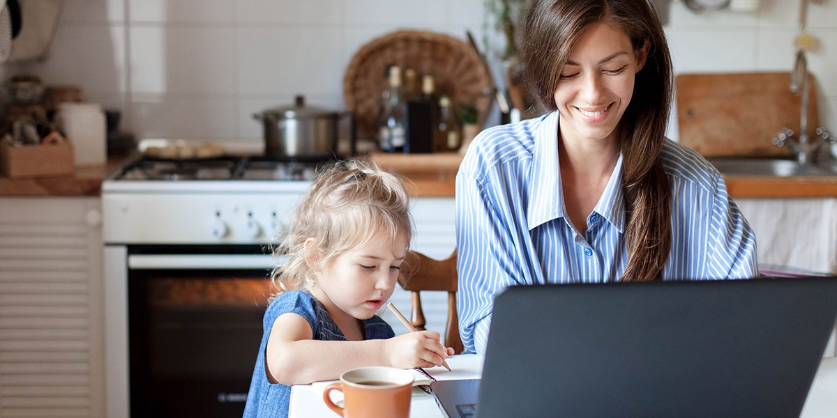 A data analyst working from home with a child next to them