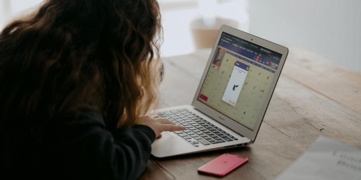An aspiring UI designer researching the best online UI design courses on a computer