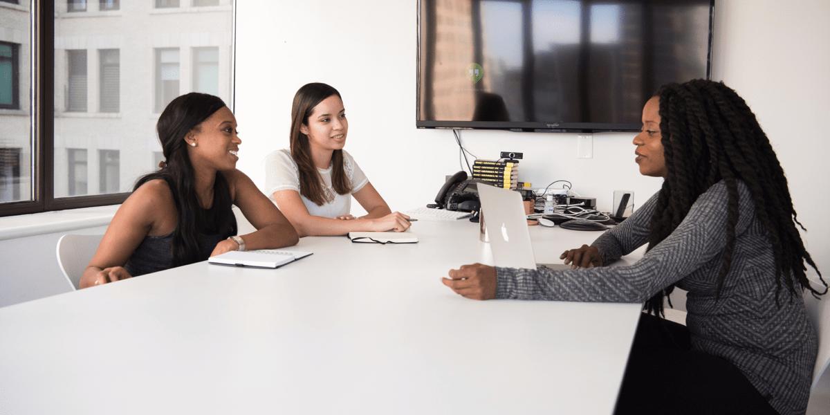 A hiring panel interviewing a UI designer