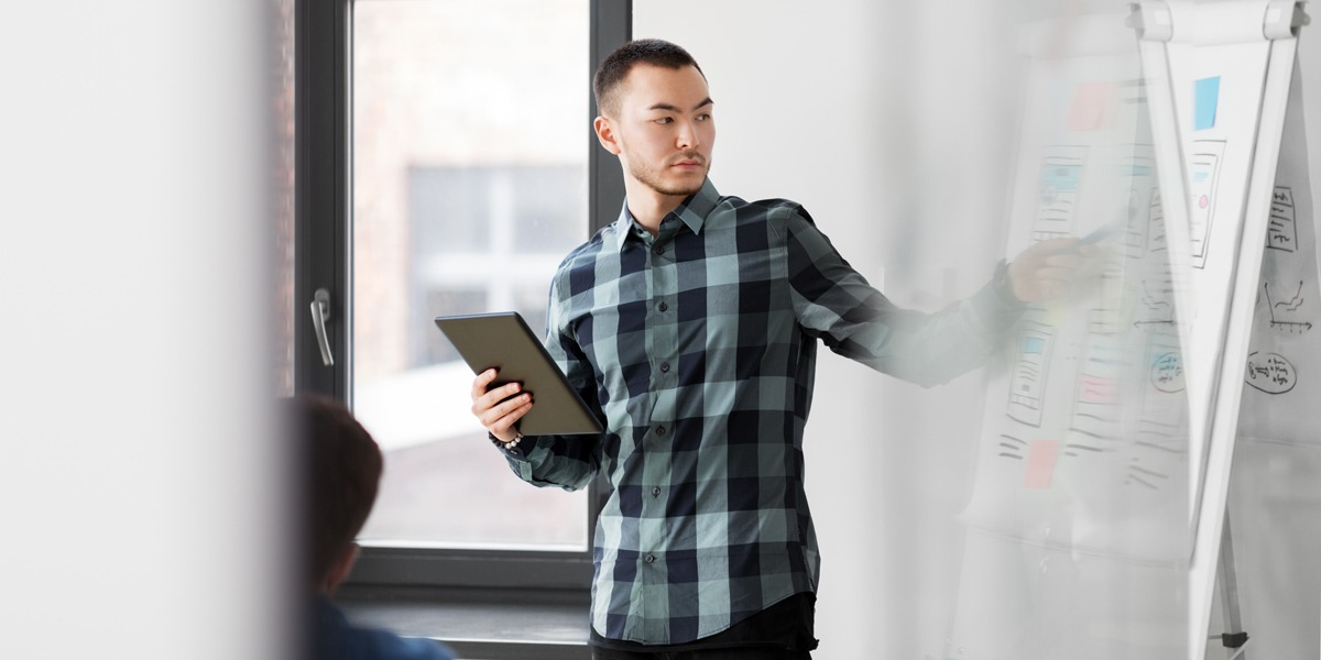 UX designer presenting ideas in an office