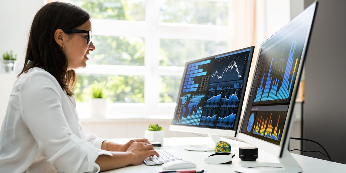 A data analyst in side profile using the xlookup function in Excel