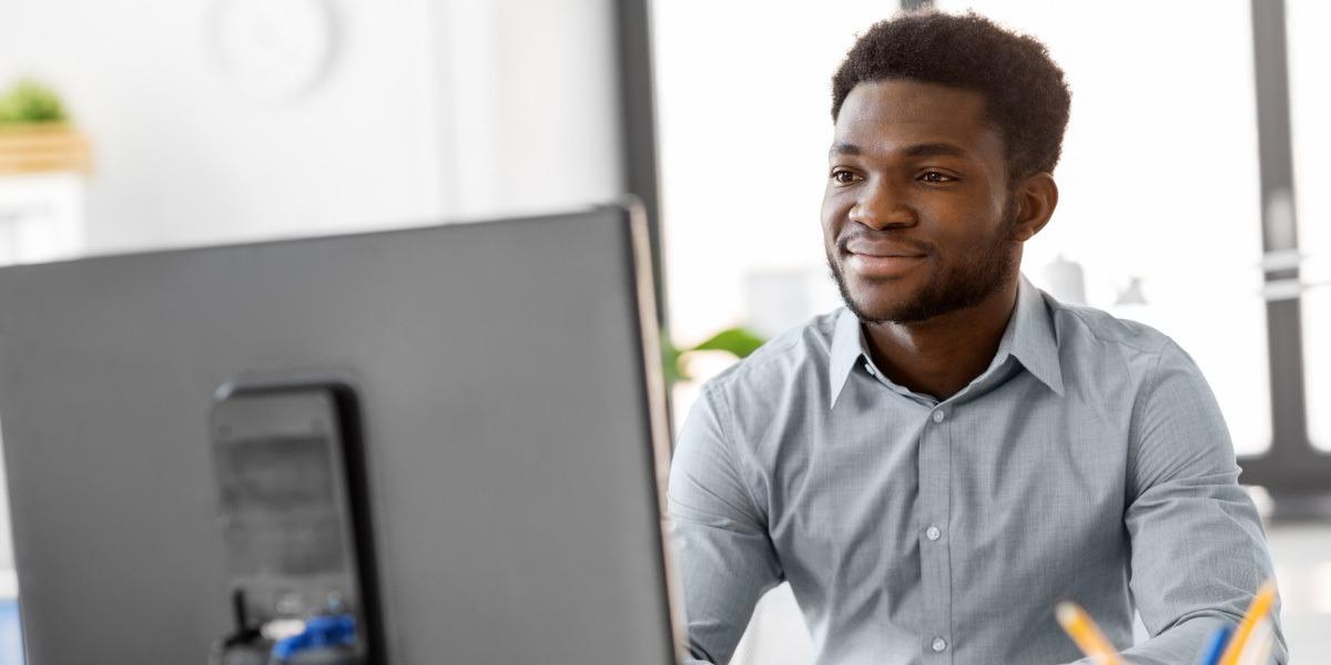 A data scientist working on a desktop computer