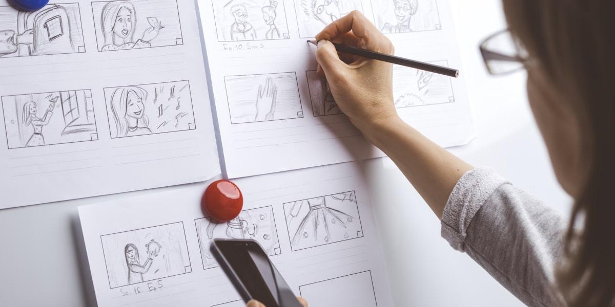 A designer sketching a storyboard